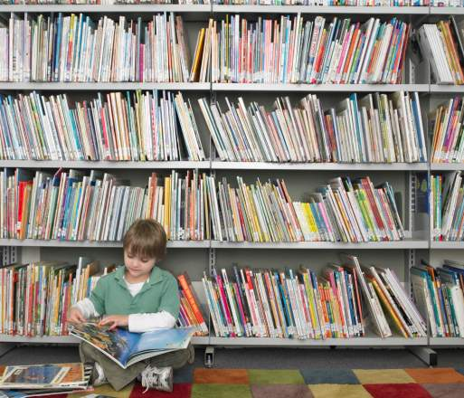 child in front of bookcase