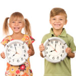 kids holding clocks