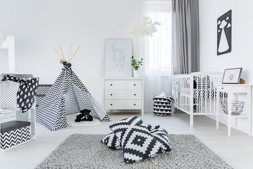 A room coloured with white and black ZigZag furniture, A teepee is in the corner