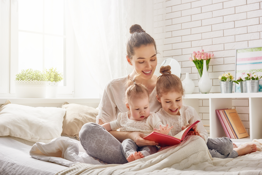 Mother reading with Children