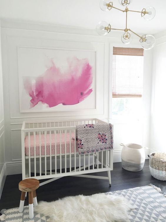 A cot in a room with artwork on the walls