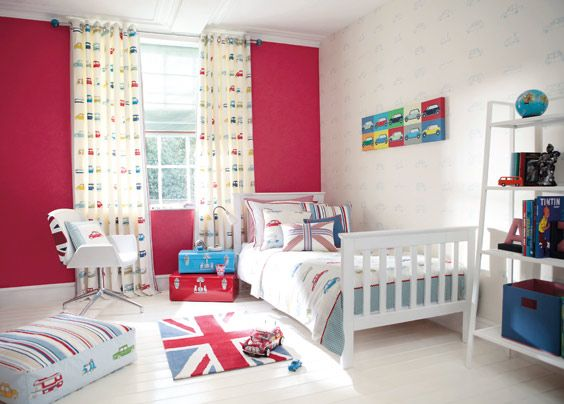 A room with a union jack theme with the bedding and carpet
