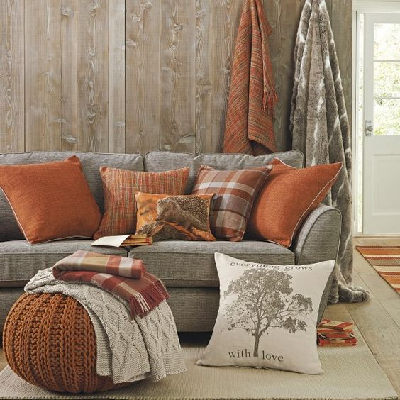 Cushions with delicate red colours complimented by a soft brown wall