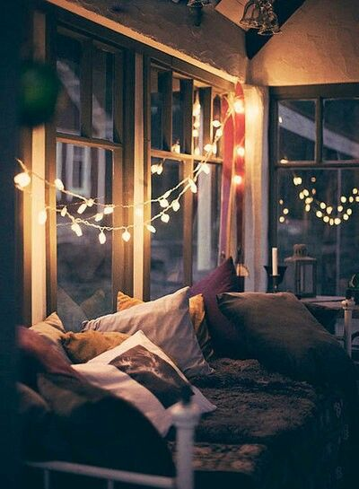 A dark room illuminated with fairy lights at night time