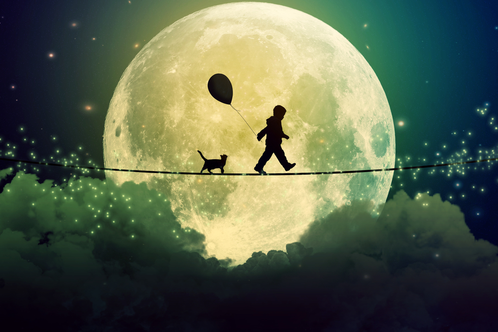 Boy walking along a tightrope with a balloon, in front of the moon.