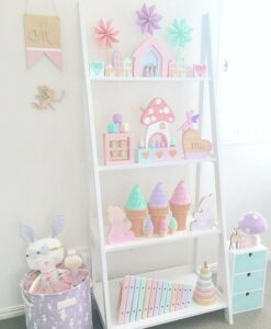 Children's bedroom shelf with pastel coloured accessories, such as ice creams.